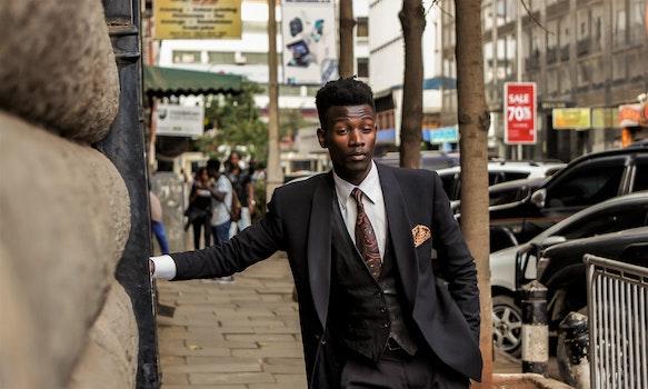Man Wearing Black Shawl Lapel Suit Jacket