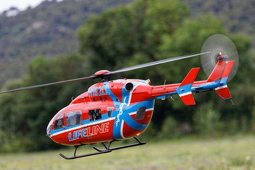 A Red Helicopter Flying
