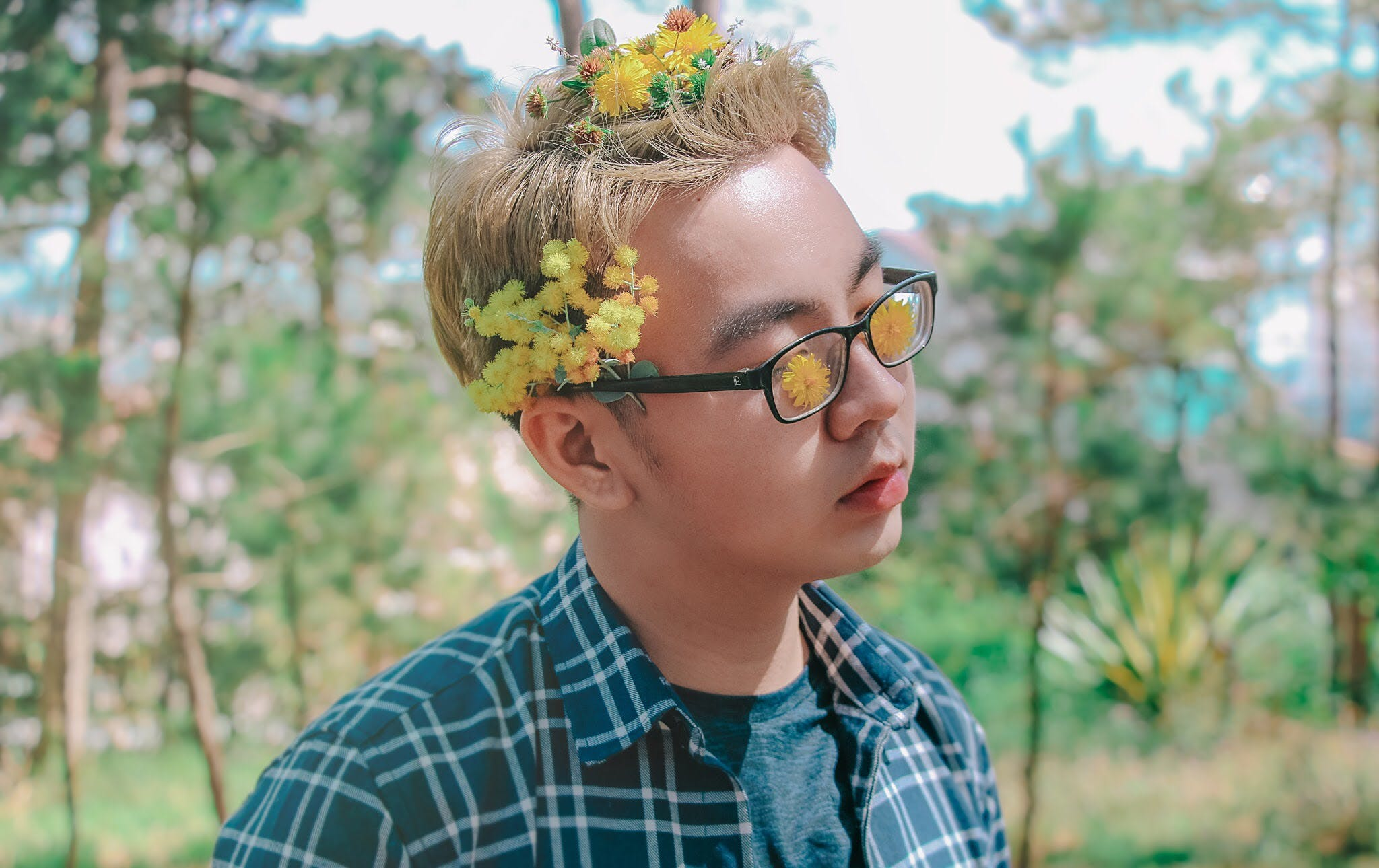 Photo of a Man with Flowers on His Hair