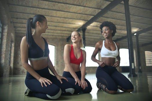 Three Women Kneeling On Floor