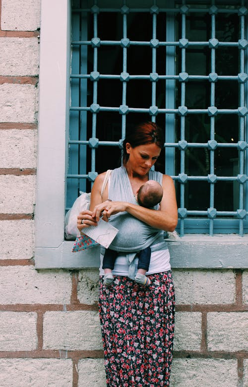A Woman Carrying a Baby