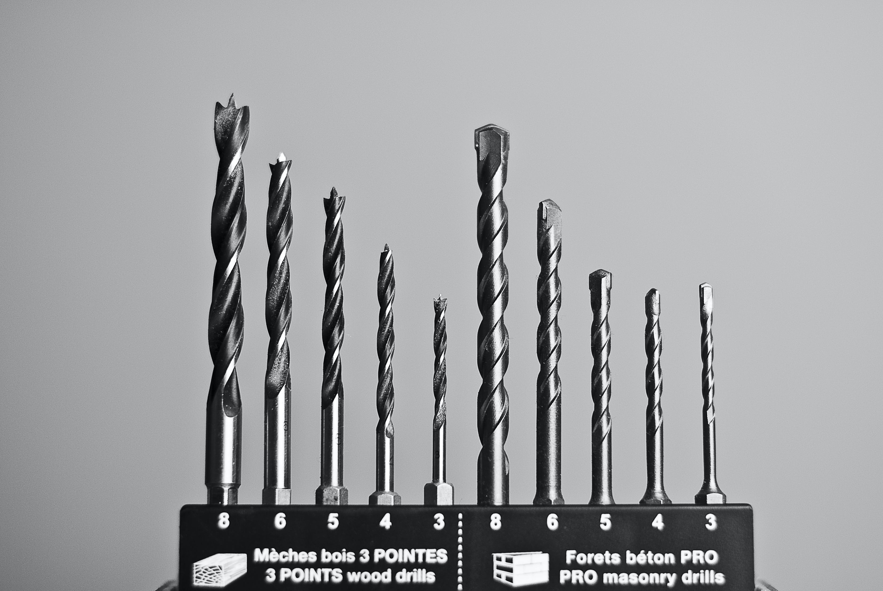 Grayscale Photography of Masonry and Wood Drills