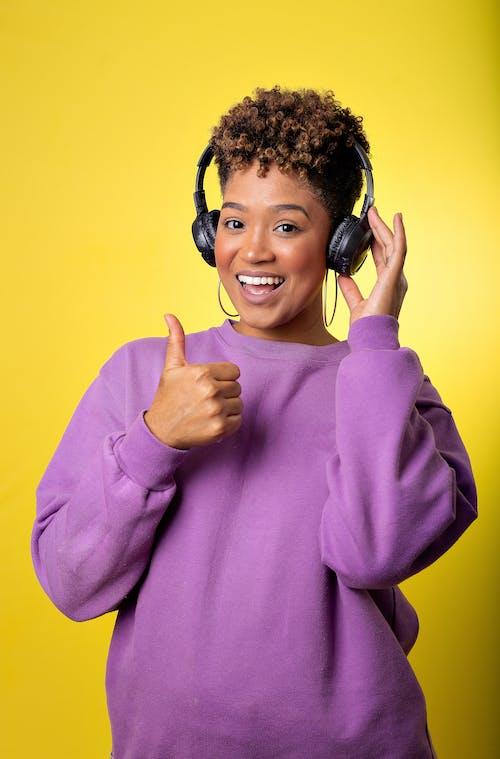 Man in Purple Long Sleeve Shirt Wearing Black Headphones