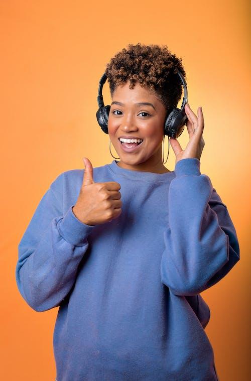 Man in Blue Long Sleeve Shirt Wearing Black Headphones