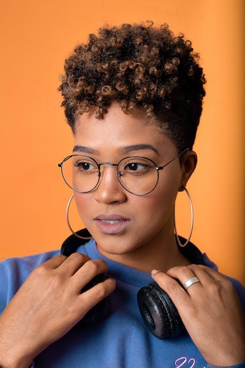 Beautiful Woman Wearing Eyeglasses and Hoop Earrings