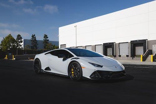 A White Lamborghini Sports Car Parked Outside