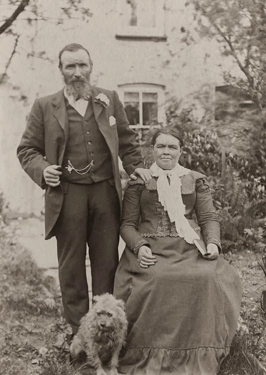 Vintage Photo of Couple With Dog