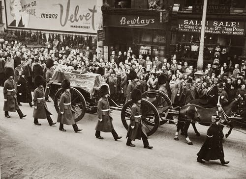 Grayscale Photo of A Funeral Procession Accompanied By Soldiers on Street