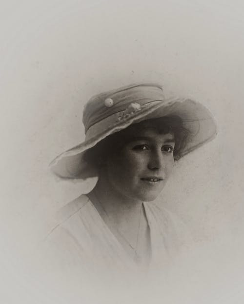Woman Wearing A Hat In Grayscale Photography