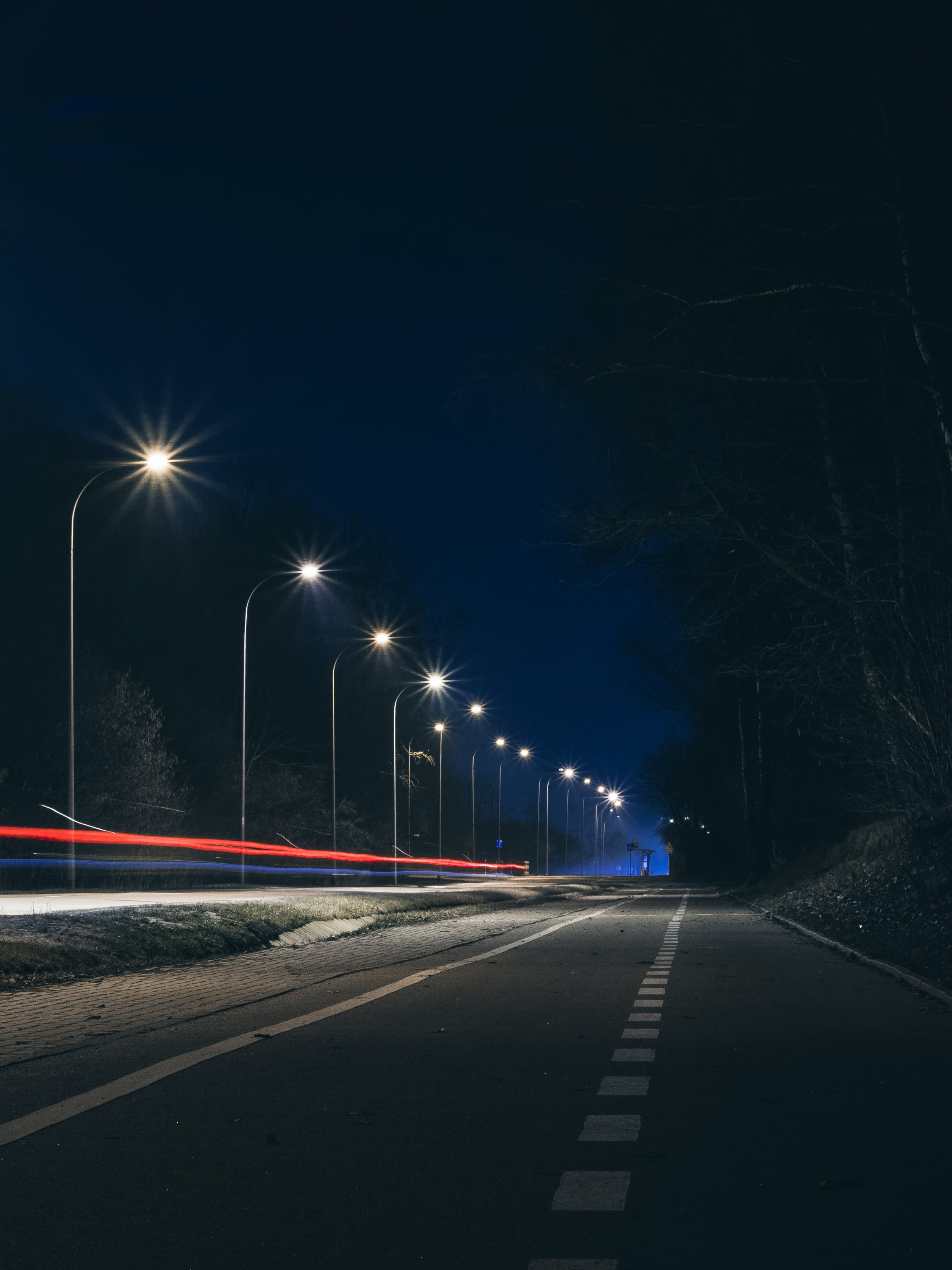 Road Near Post Lamp at Night Time