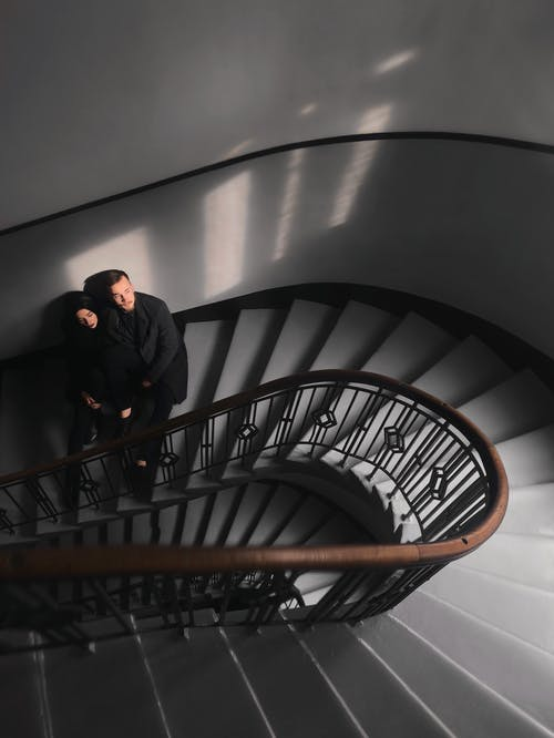 Woman and Man Standing on Stairs