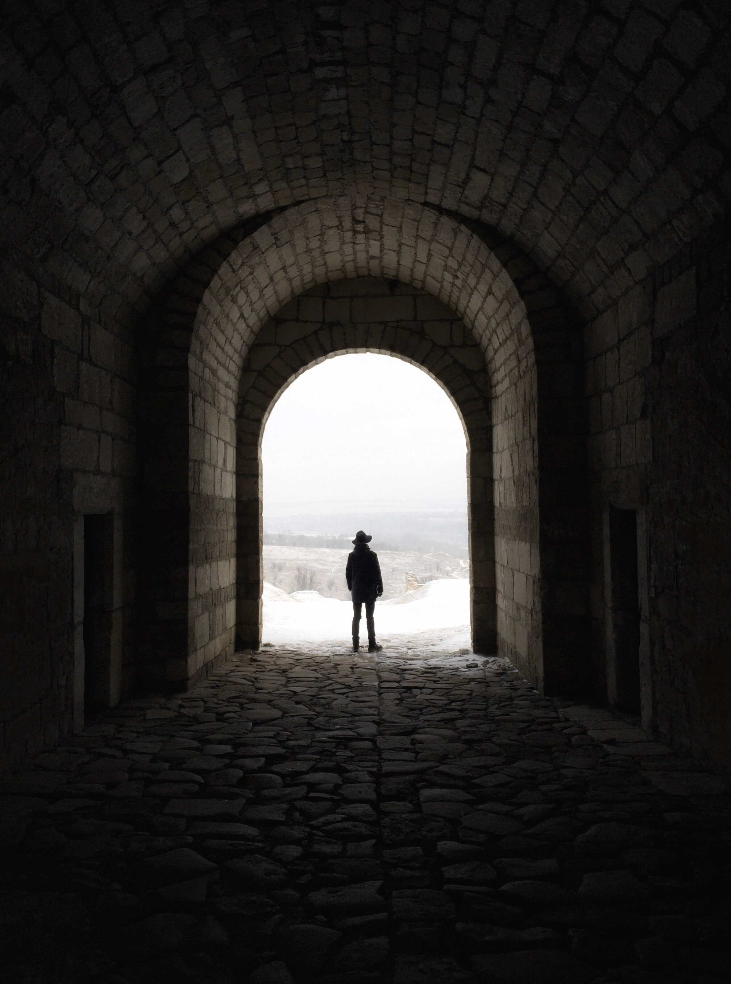 Greyscale Photography Of Man Walking On Tunnel 183 Free