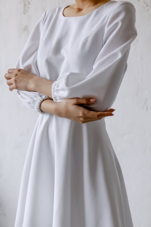Kostnadsfri bild av armarna korsade, bakgrund, klänning