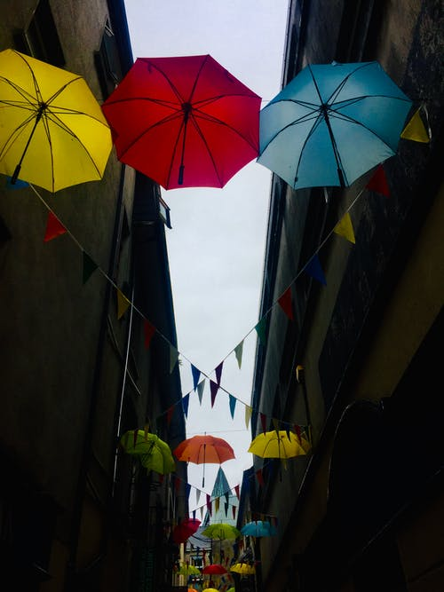 Free stock photo of colourful umbrellas, rainbow, street decor