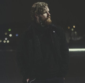 Man Wearing Black Zip-up Jacket Taking Picture during Nighttime