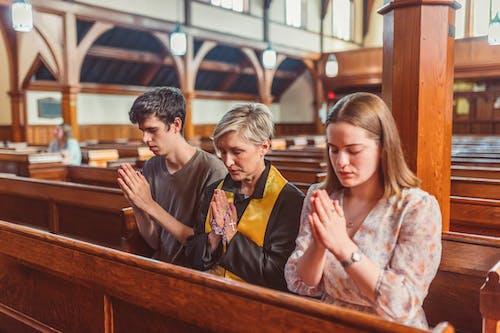 People Praying Inside The Church