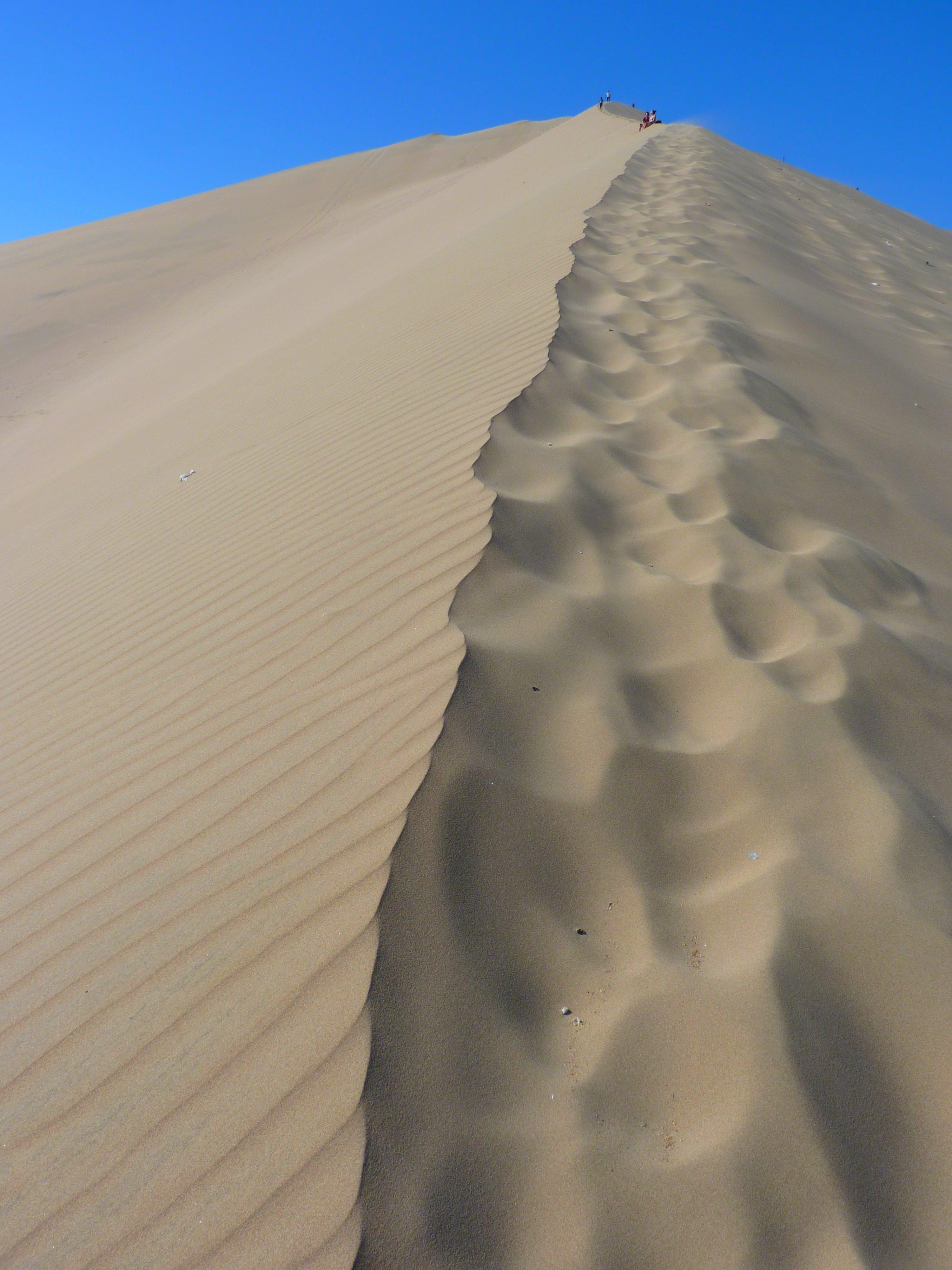 Brown Sand Dunes Under Blue Sky