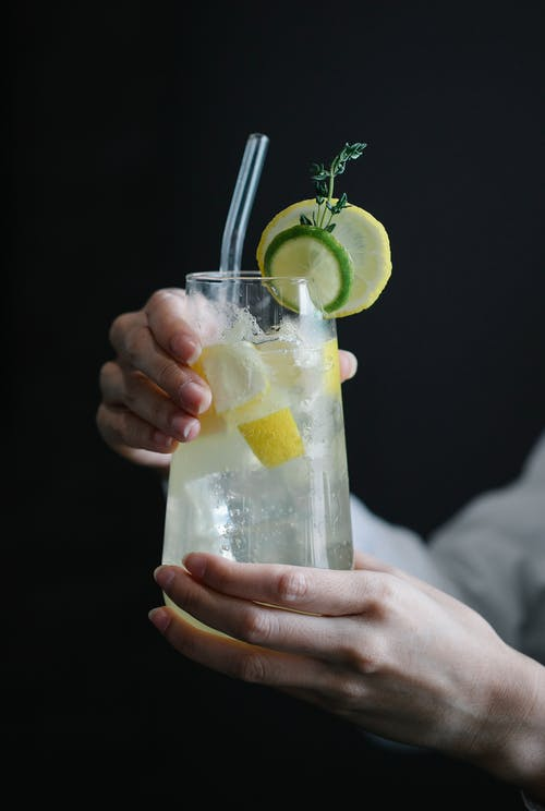 Person Holding Clear Drinking Glass With Lemonade