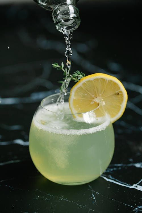 Cocktail Drink In Clear Glass With Slice of Lemon