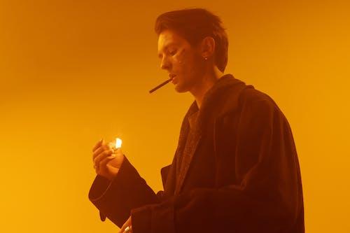Woman in Black Coat Smoking