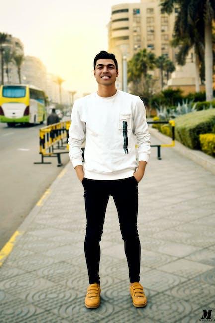Man in White Crew-neck Sweater Taking Selfie Beside Street Road