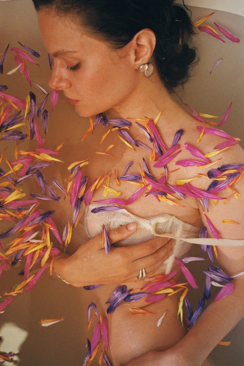 Woman in Purple and Pink Feather Costume
