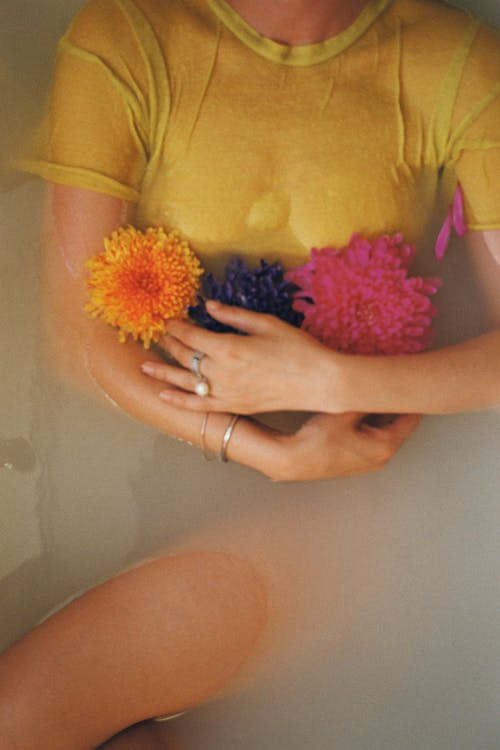 Woman in Yellow T-shirt Holding Yellow and Pink Flower Bouquet