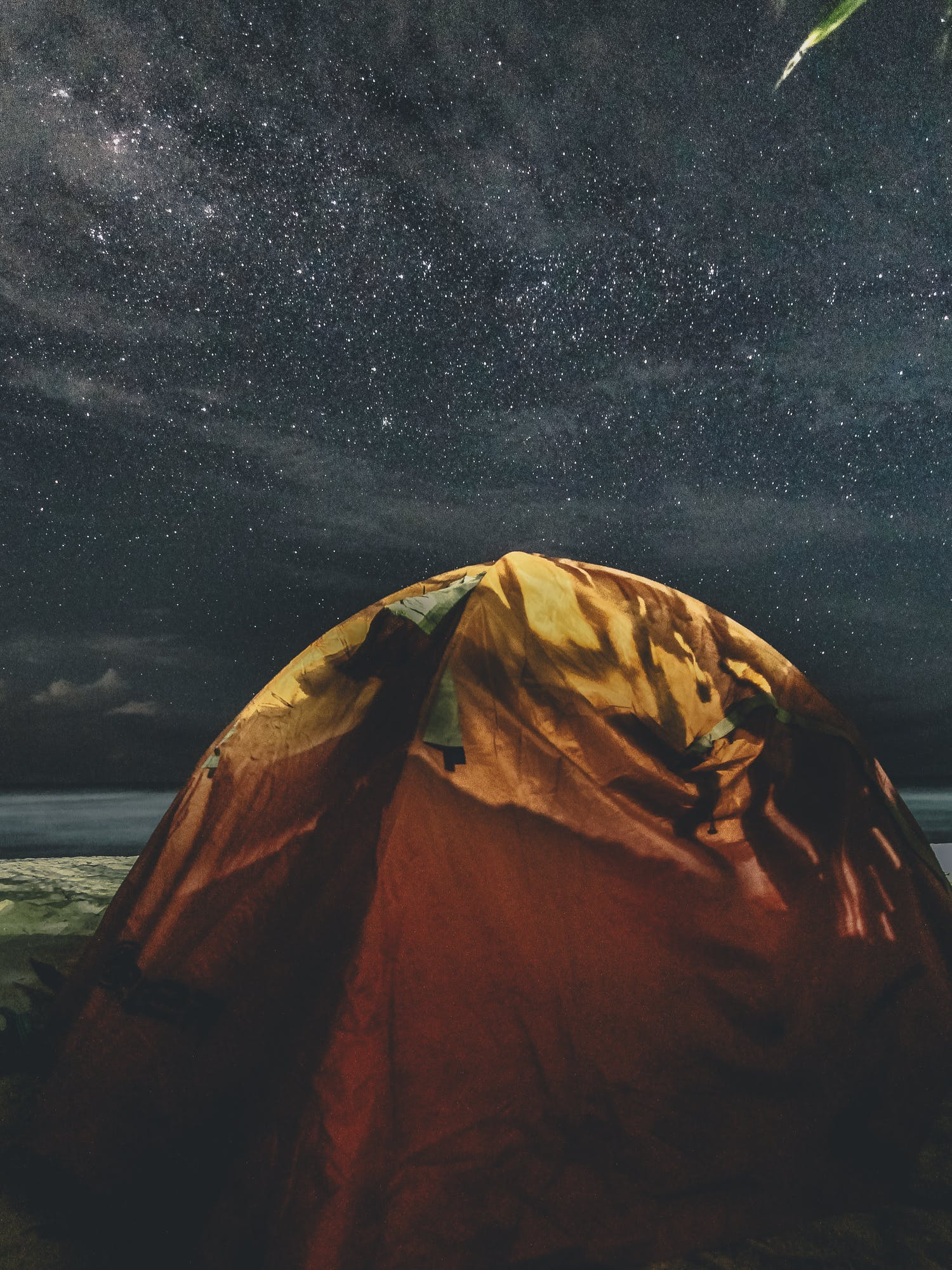 Orange and Green Camping Tent Under Starry Sky
