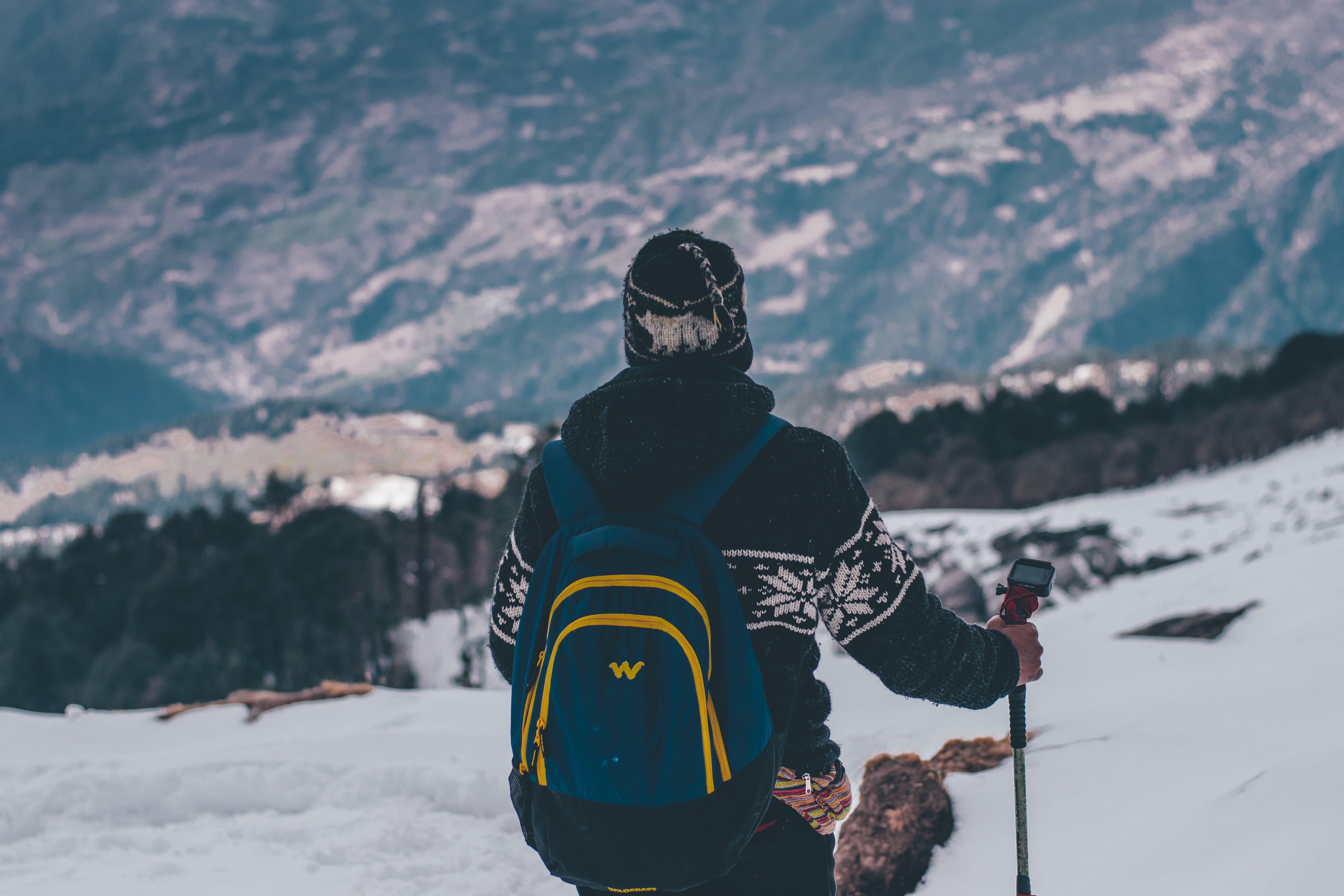 Man in Black and White Jacket and Blue Backpack Doing Snow Ski