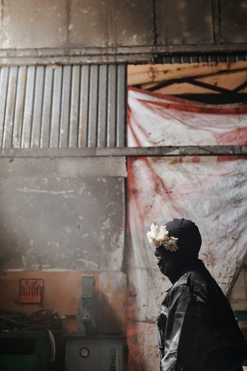 Woman in Black Hijab Standing Near Gray Wall
