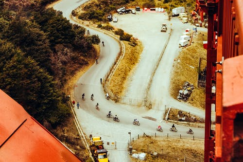 Foto profissional grátis de ciclismo, ciclistas, dia, estrada