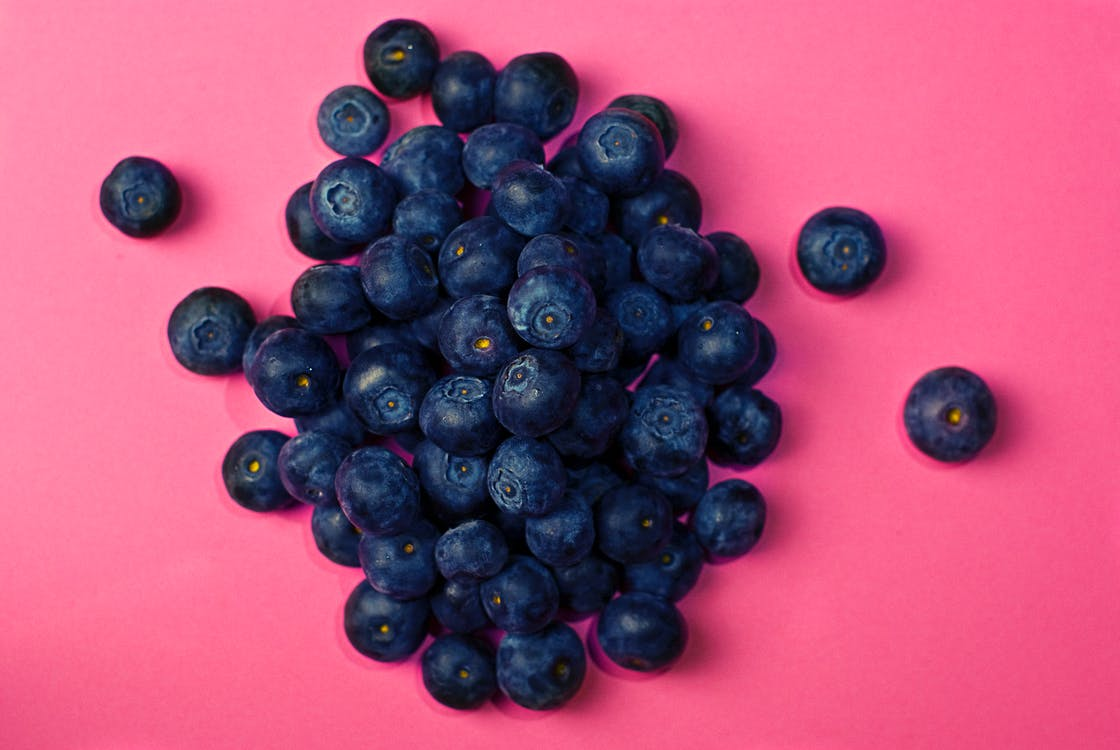Blueberries on Pink Surface