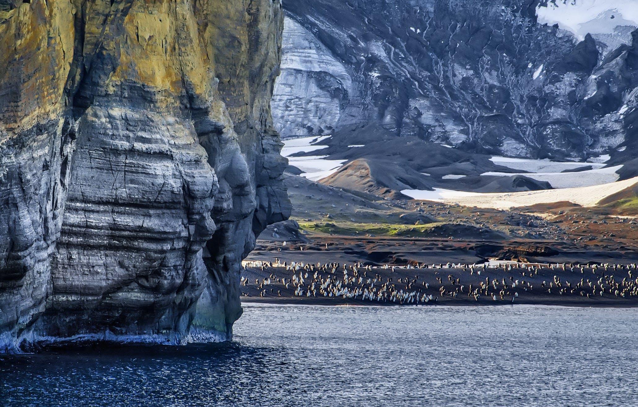 Gray Stone Mountain Beside Body of Water