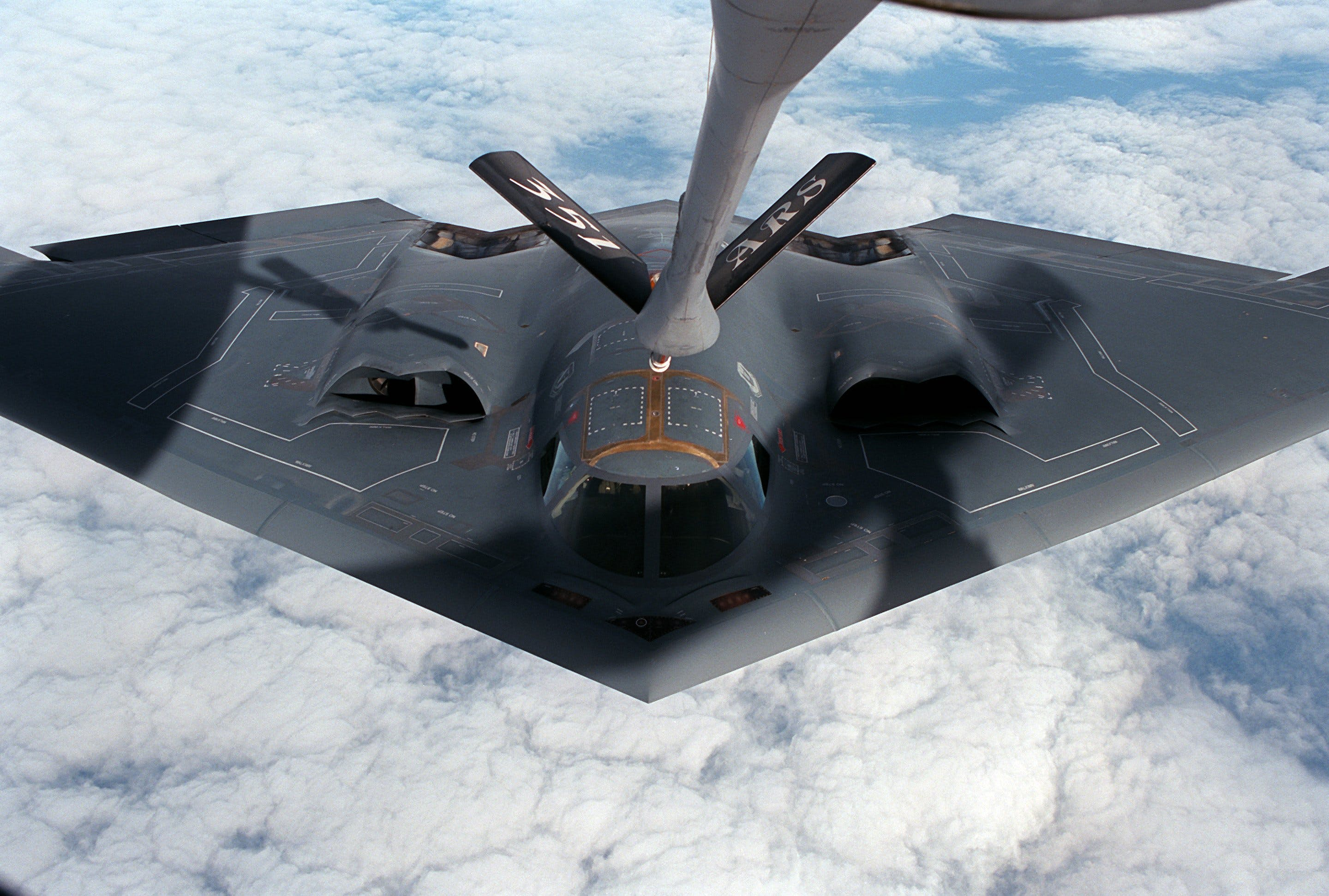 Gray Fighter Drone Above White Clouds
