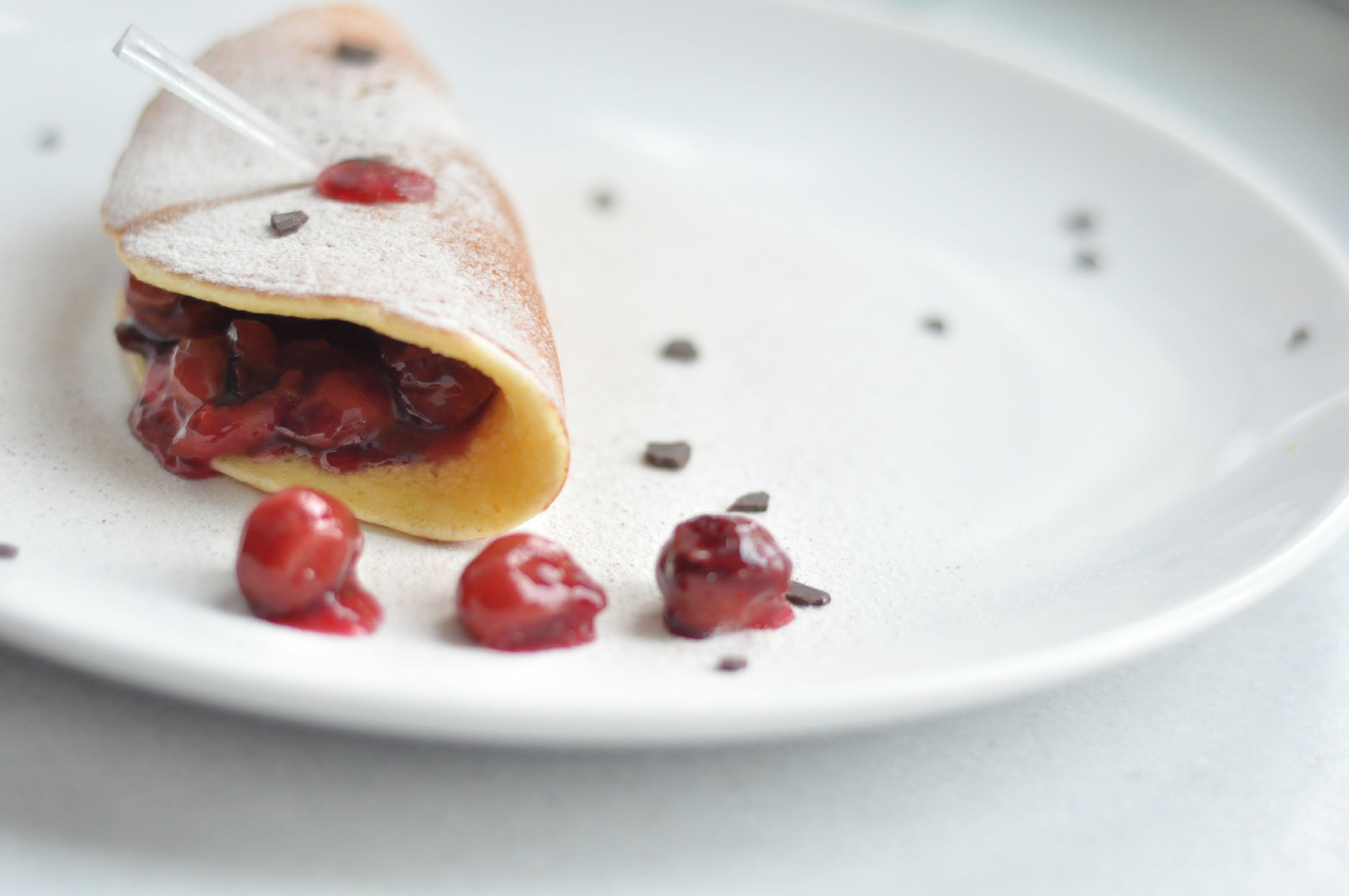 Cherry Crepe Dish on Round White Ceramic Plate