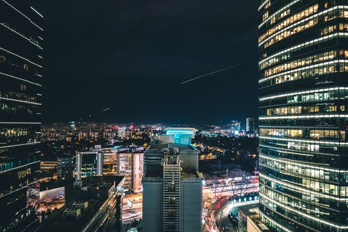 High Rise City Building during Night Time Photo
