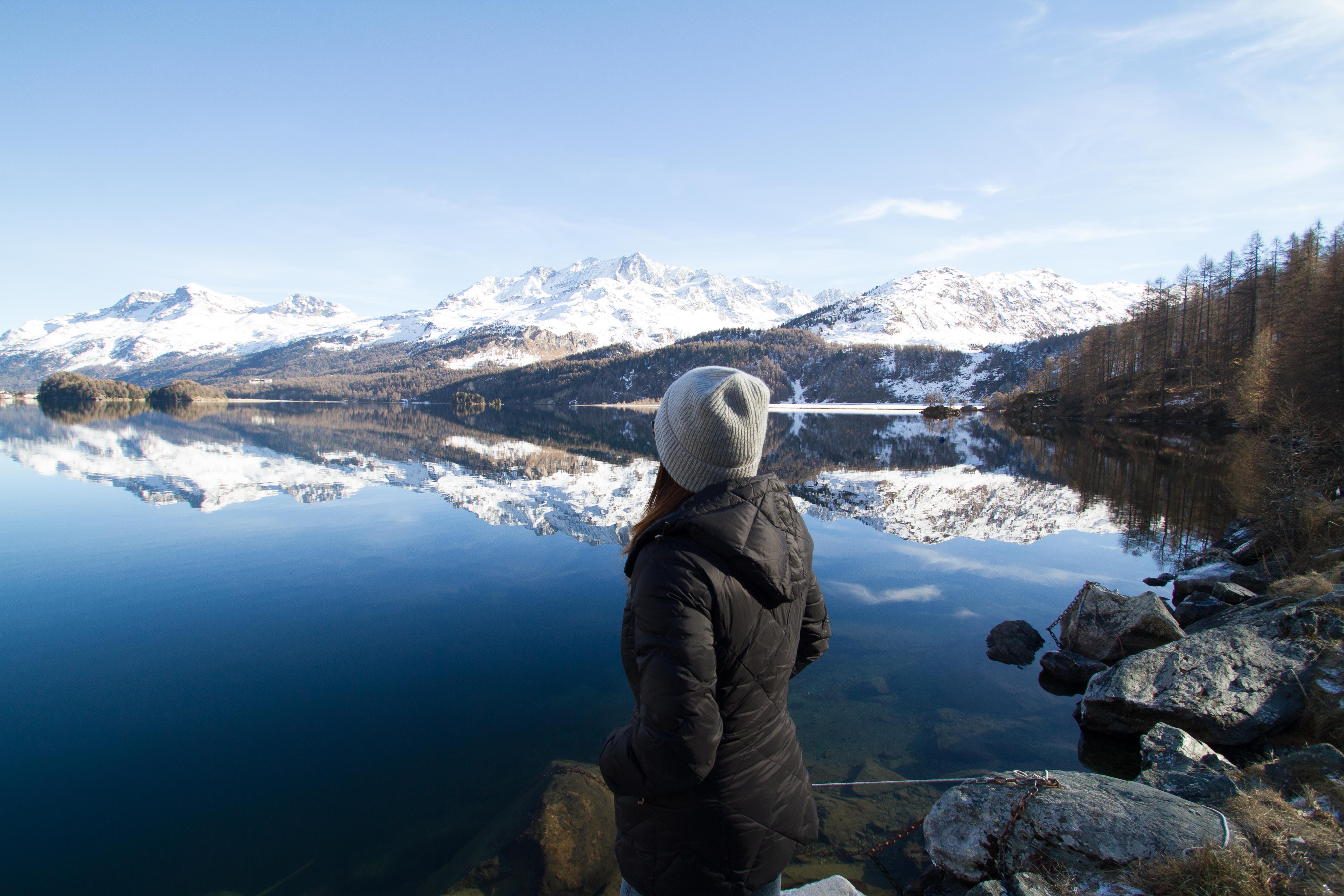 Woman Wearing Black Hooded Jacket Watching Mountain