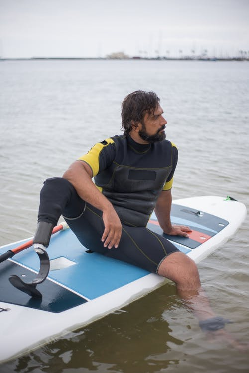 Man Sitting on a Standup Paddleboard
