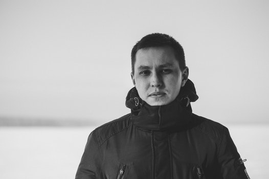 Grayscale Photography of Man Wearing Jacket