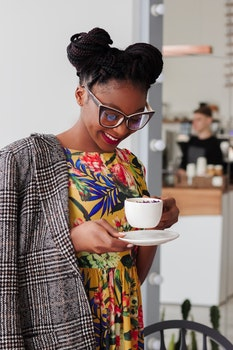 Woman Standing Holding Coffee Mug