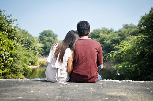 Back View of a Romantic Couple Sitting Together