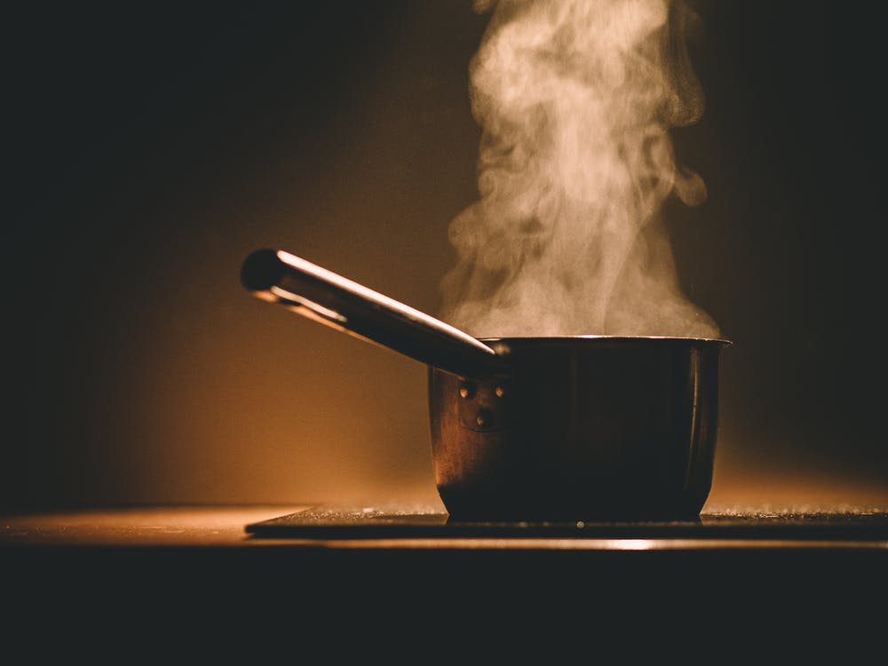 Black Cooking Pot and Smoke in Close-up Photography