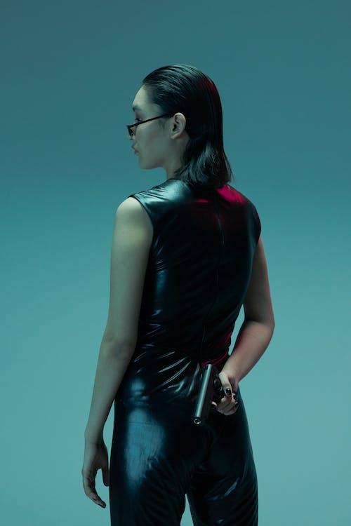 Woman in Black Sleeveless Top Wearing Sunglasses