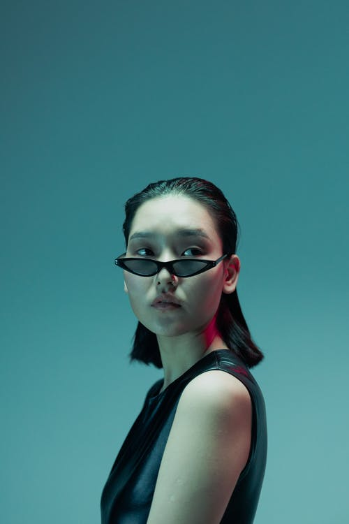 Woman in Black Tank Top Wearing Black Framed Sunglasses