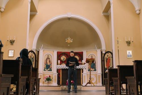 Man in Black  Longsleeves Reading a Bible