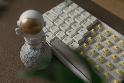 Free stock photo of action figure, apple mac, astronaut