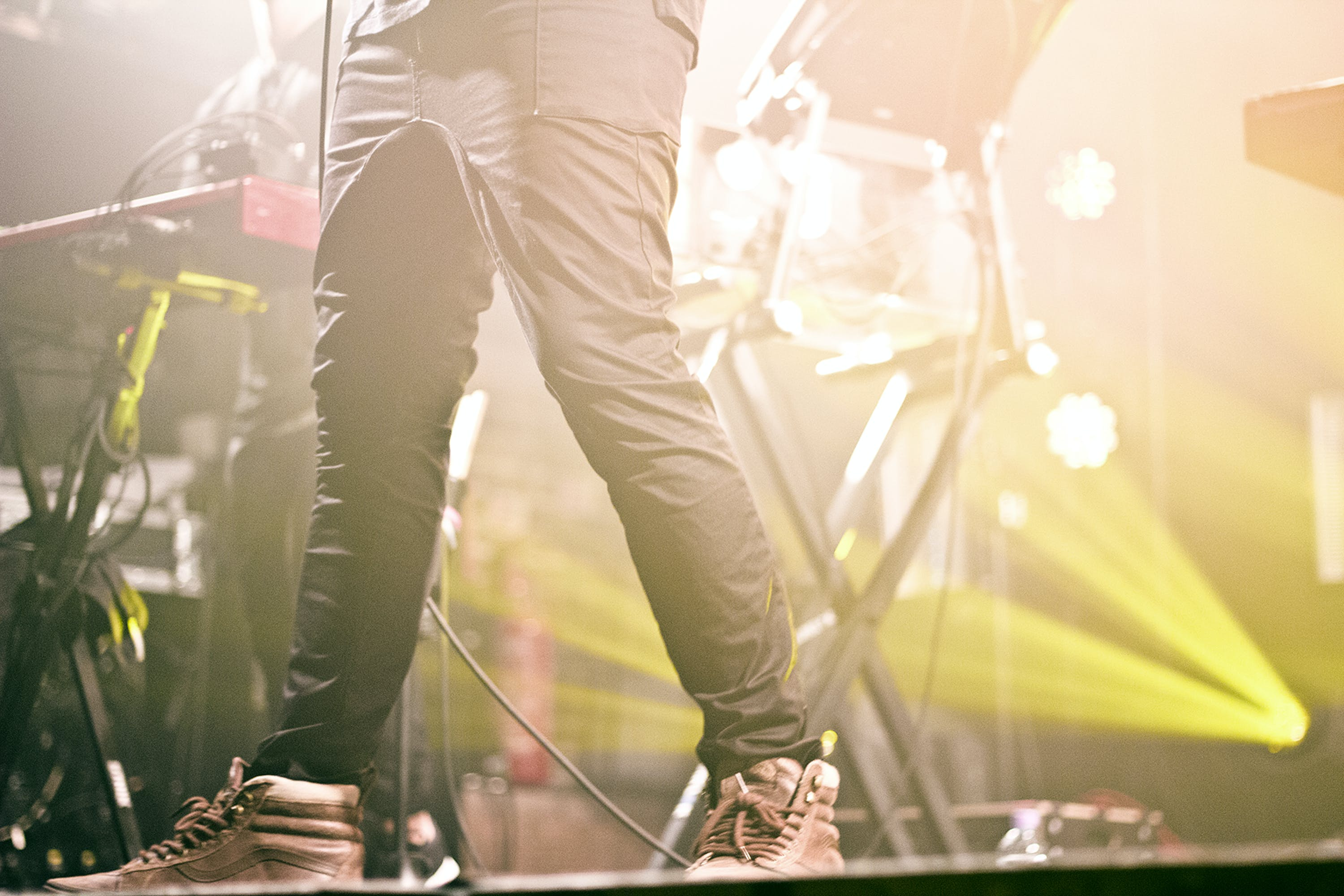 Person in Black Pants on Stage