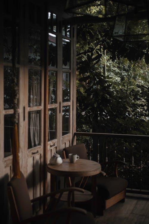 Brown Wooden Glass Door Near Brown Wooden Table
