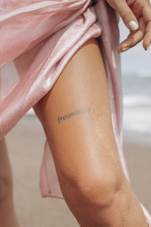 Woman With Tattoo on Her Leg
