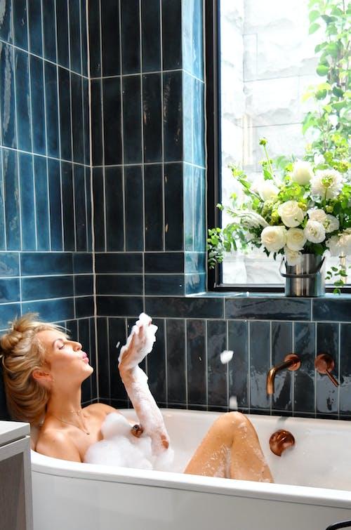 Photo of a Woman in Bathtub